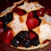 A fruit pie made from strawberries and blackberries, with cut out stars as the crust.