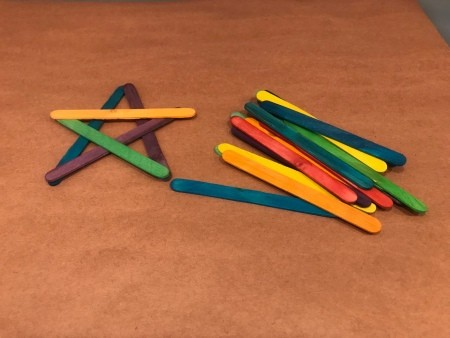 4th of July Craft Stick Star with Streamers - one star and pile of colored craft sticks