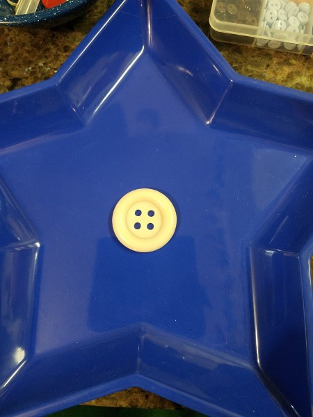 Blue Star Wall Hanging - larger white button in the center of the plastic tray