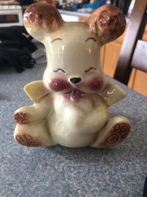 A ceramic bear piggy bank.