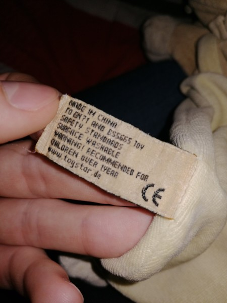 The tag on an old plush toy.