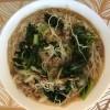 A finished bowl of pork noodle soup.