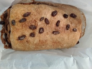 The baked loaf of cinnamon raisin bread.