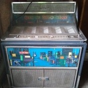 Value of a Seeburg Jukebox? - gray and chrome cabinet jukebox