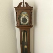 A wooden grandfather clock.