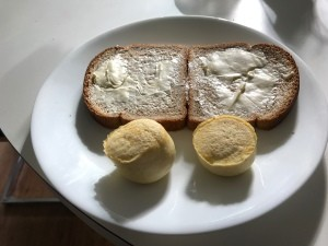 Two egg bites on a plate with toast.