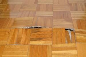 A damaged floor in need of repair.
