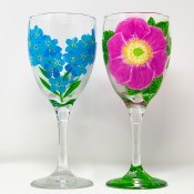 A pair of hand painted wine glasses.