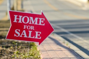 """An arrow sign that says """"Home for Sale"""""""