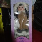 A doll still in the box.