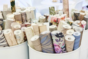 Rolls of wallpaper in containers.