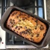 A baked loaf of banana bread with chocolate chips.