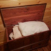 A Lane chest with linens inside.