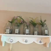Decorative glass jars being used as vases.