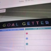 """A pad of paper that says """"Goal Getter"""" at the top."""
