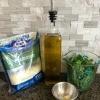 Ingredients for basil garlic parmesan sauce.