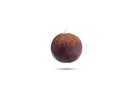 An Irish potato candy covered in chocolate.