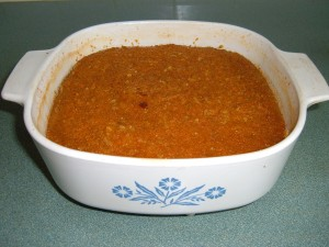 A completed pan of grated sweet potato pudding.