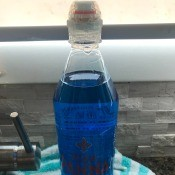 Disposable Sport Water Bottle to Hold Dish Soap - clear bottle with blue dish soap
