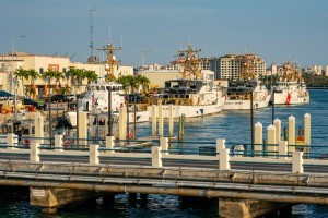 Several coast guard ships at a dock in Miami, FL.