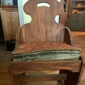Value of an Antique Chair? - plain medium finish chair with straight notched back with cut in handle