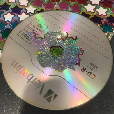 Hanging CD Reflective Star Room Decor - using sticker scraps to cover the center of the CD
