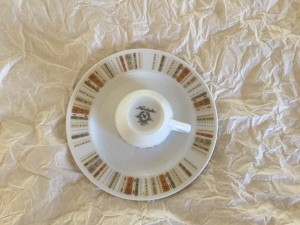 Identifying a Noritake Pattern? - upside down cup and white plate with earth tone rectangles around the outer edge