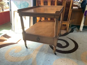 A wooden end table.