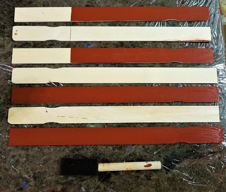 Wooden Stick Flag and Stars- sticks laid out with grip alternating, blue field marked and then the appropriate sticks painted red