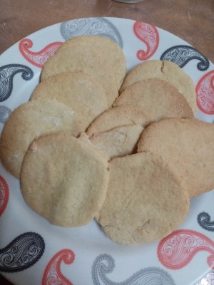 Baked sugar cookies on a plate.
