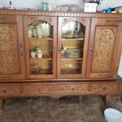 Identifying a China Hutch? - low, 4 door cabinet, 2 with perhaps leaded glass, lots of dimensional filigree on doors