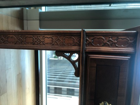 The decorative front to a wooden desk.