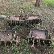 A rusty piece of farm equipment in a field.