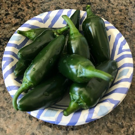 A bowl of whole jalapeños.