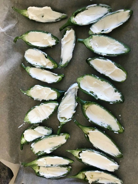 Jalapeño halves filled with cream cheese.