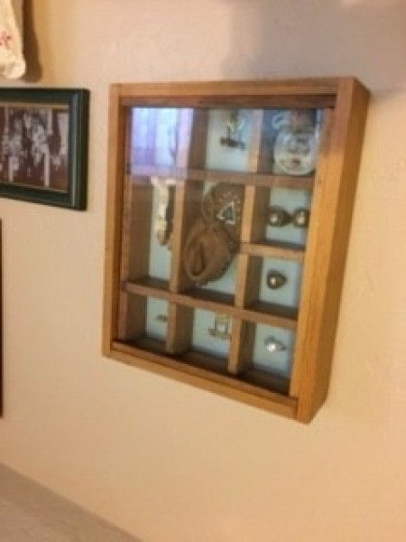 Shadowbox Displays - shadowbox hanging on the wall near a photo