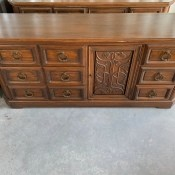 Value of Conant Ball Furniture? - dresser with three sets of drawers and one door panel
