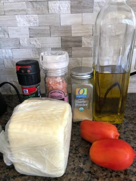 Ingredients for baked tomatoes with mozzarella.