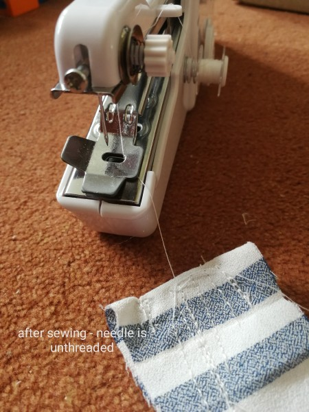 Handheld Sewing Machine Keeps Unthreading? - long loose thread