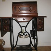 Age and Value of a White Treadle Sewing Machine? - base cabinet and machine in wooden box