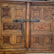Identifying a Large Wooden Chest? - old carved two door wood chest with metal latch