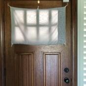 Hanging Window Door Covering - finished covering over the entry door window