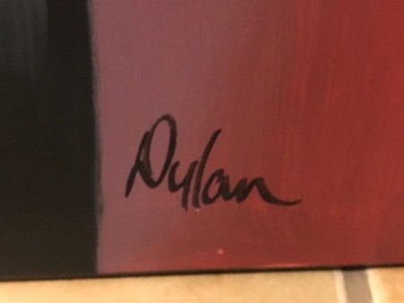 An artist's signature on the painting.