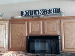 Farmhouse Style Signs - finished sign over the kitchen cabinets
