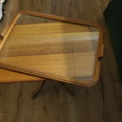 A small table with a glass tray on top.
