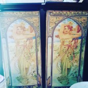 Two cabinet doors with a painted redheaded woman.
