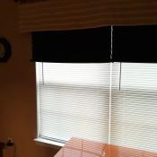 Black accordion shades on a west facing window.