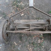 An old metal push mower.