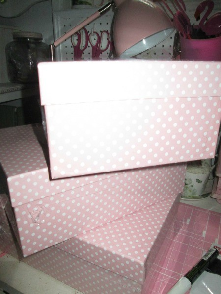 Pink and white shoe boxes for organzing.
