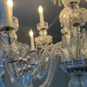 A crystal chandelier in a dining room.
